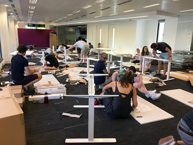 Photo of Monzo staff building IKEA furniture